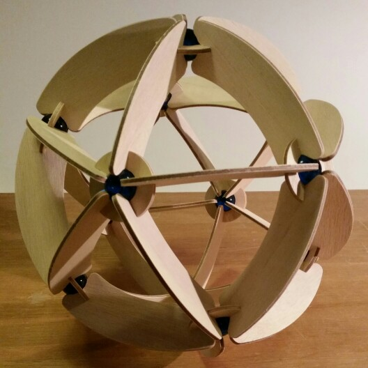Sphere shaped icosahedron made out CNC cut plywood and blue marbles